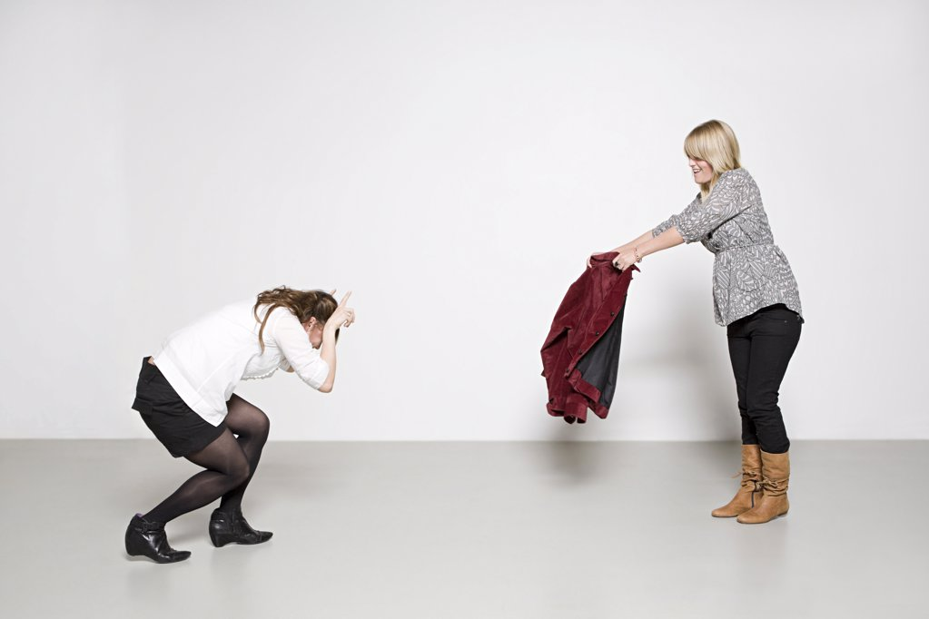 Stock Photo: 1439R-1095608 Women pretending to be bull and bullfighter