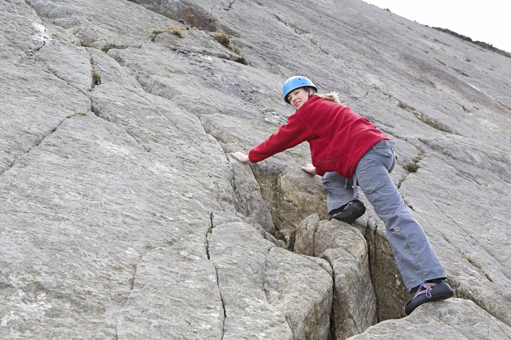 A woman rock climbing : Stock Photo