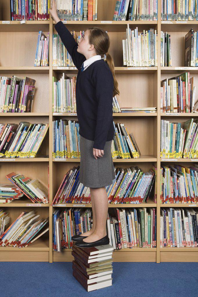 Girl in library : Stock Photo