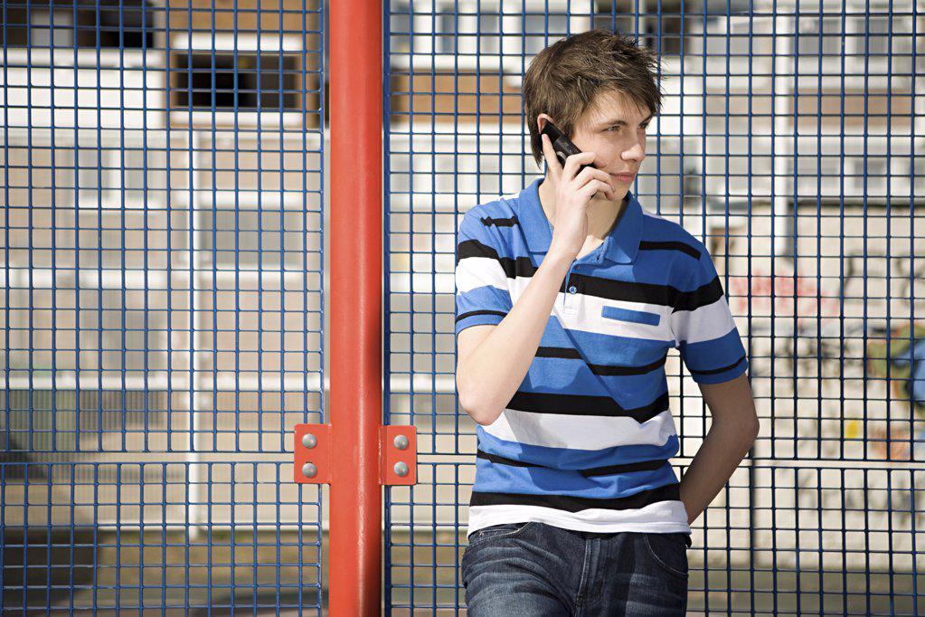 Stock Photo: 1439R-1096313 Teenage boy on cellphone