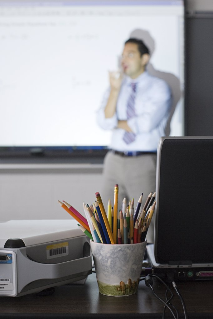 Stock Photo: 1439R-1099012 A teacher in a classroom