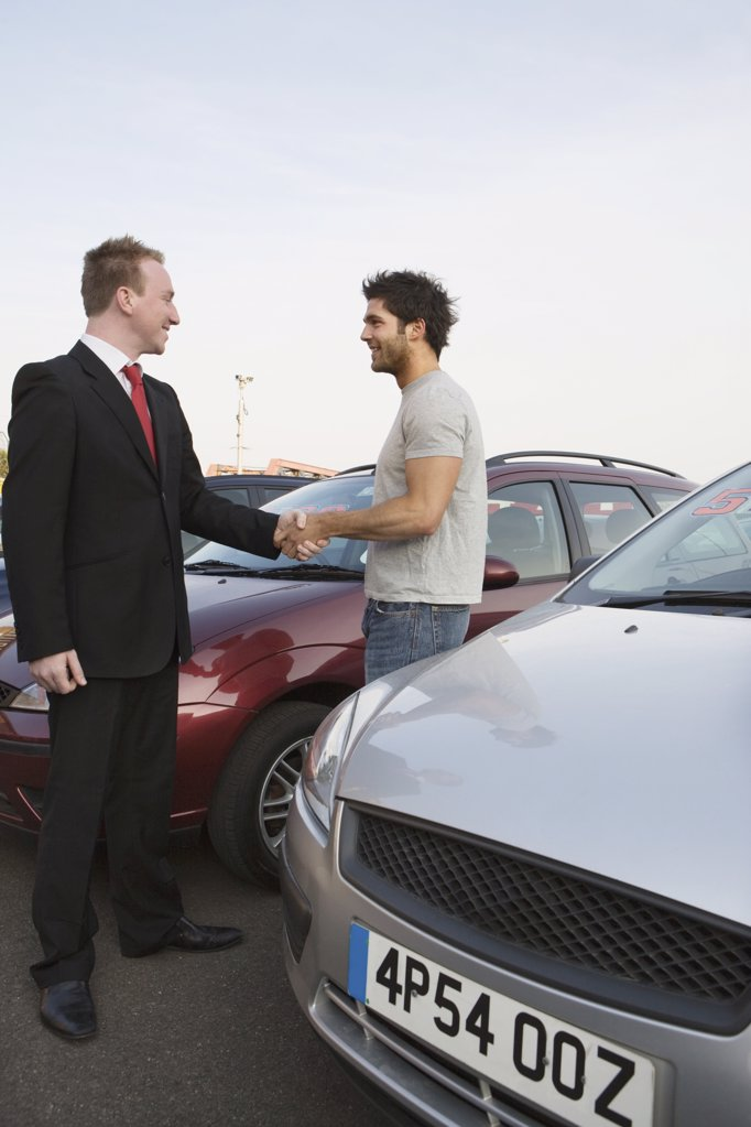 A man shaking hands with a salesman : Stock Photo
