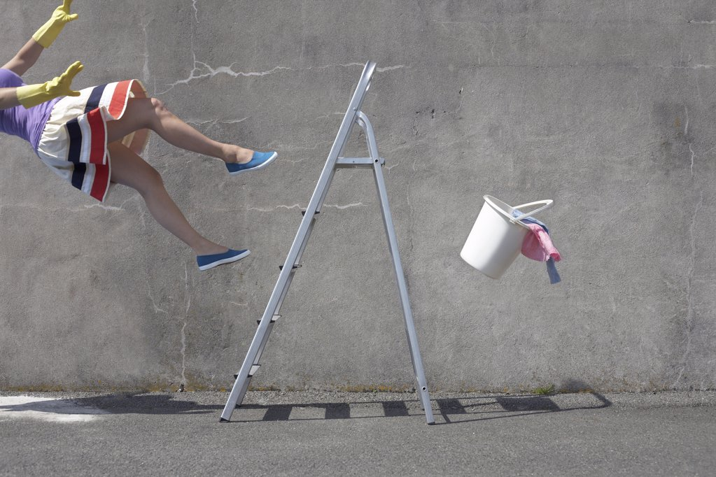 Stock Photo: 1439R-1099922 Woman falling off a ladder