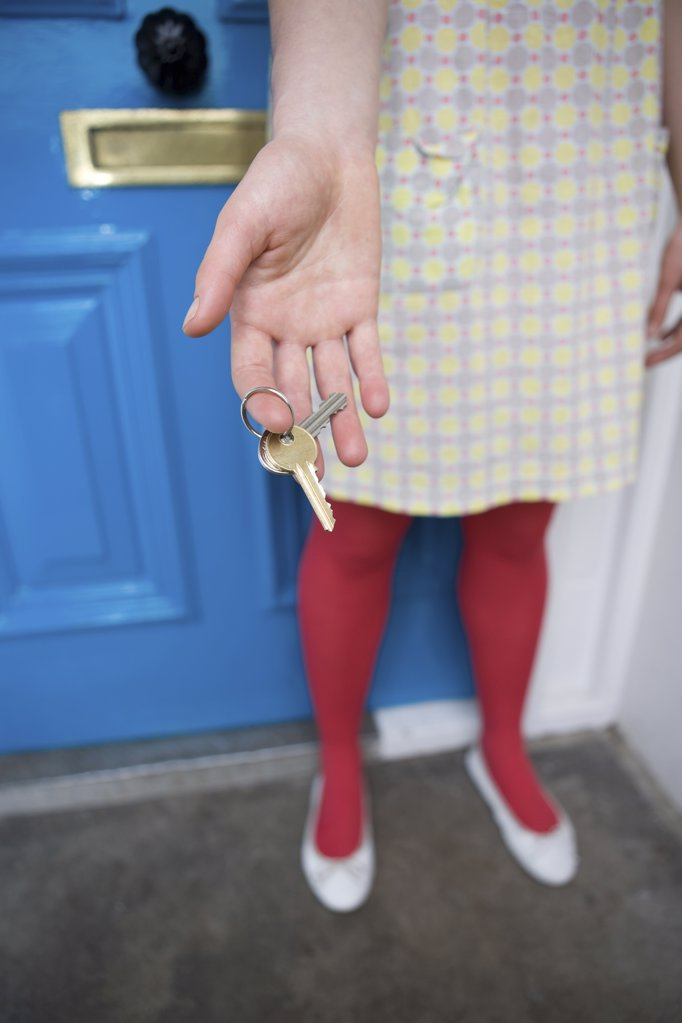 Woman holding door keys : Stock Photo