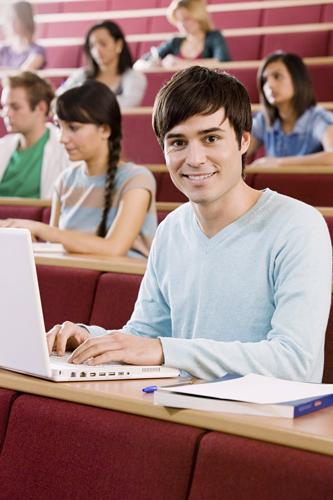 Male student in lecture : Stock Photo