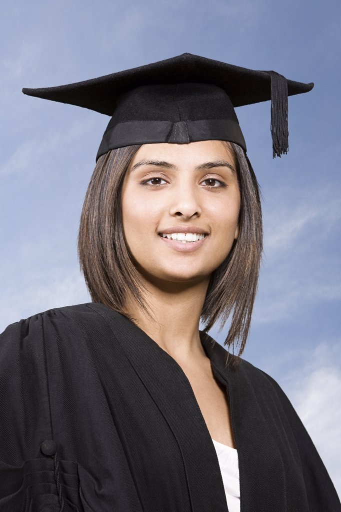 Young woman graduating : Stock Photo