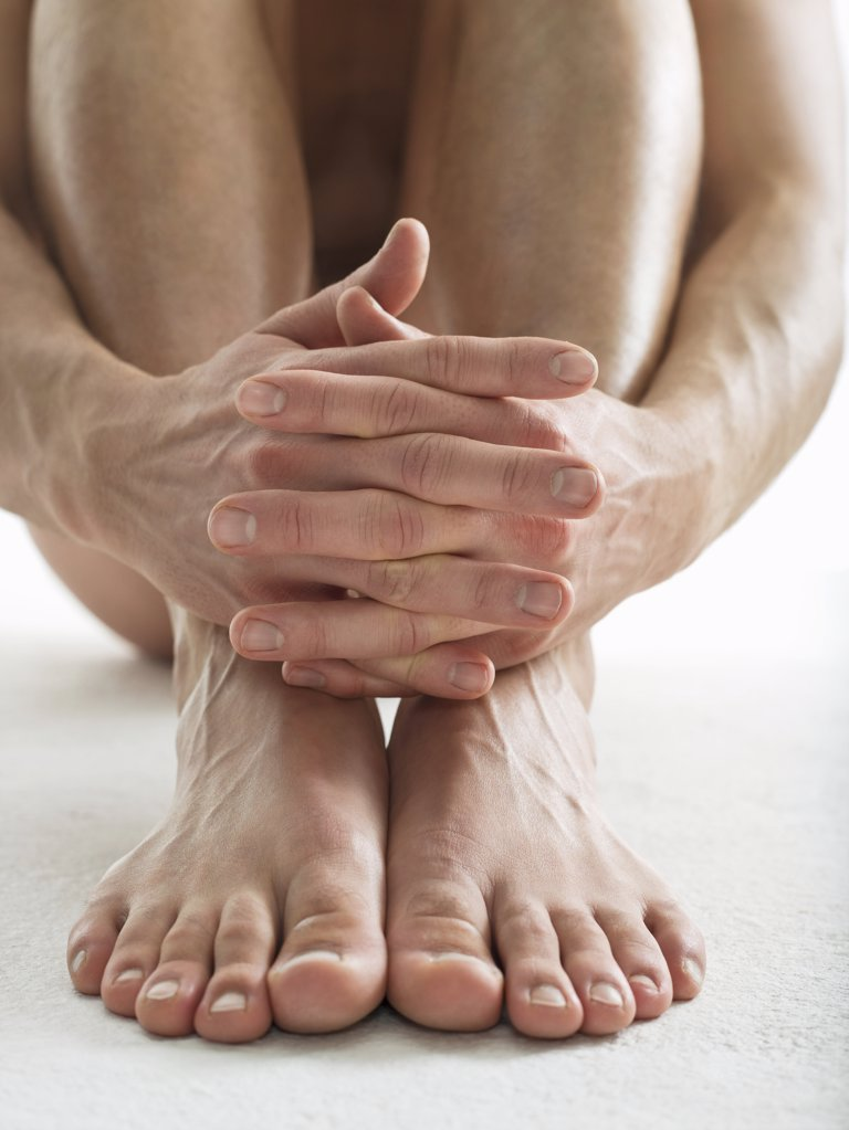 Hands and feet of man : Stock Photo