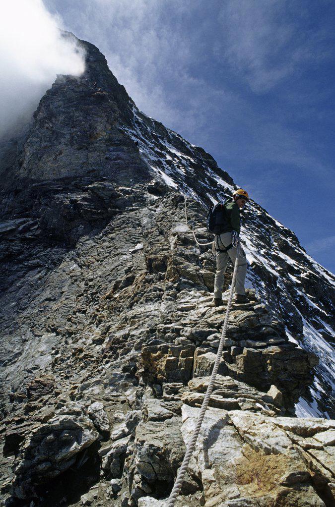 Climber descending hornli ridge on matterhorn : Stock Photo