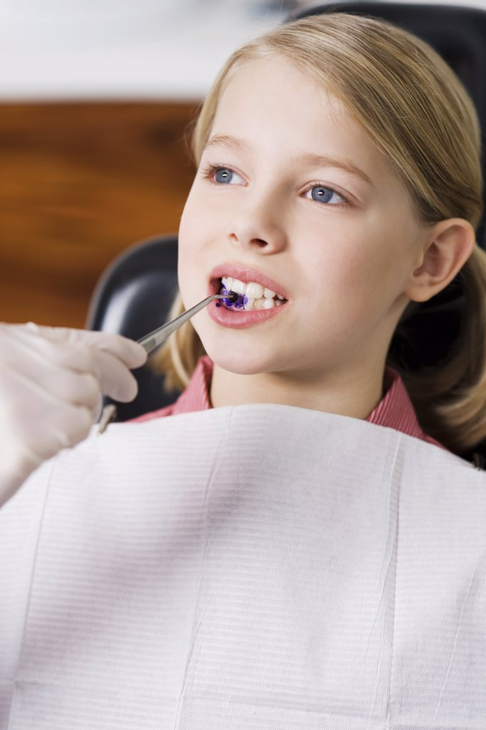 Girl at dentists office : Stock Photo