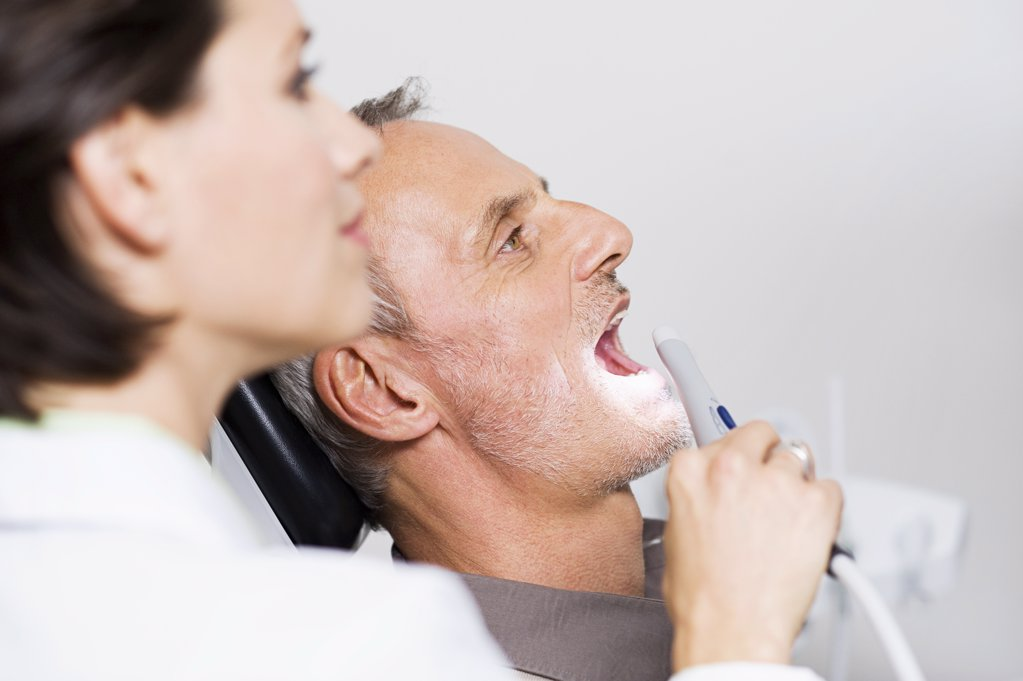 Dentist and patient : Stock Photo