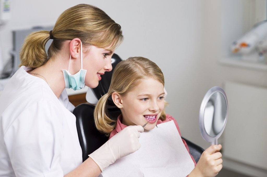 Girl and dentist : Stock Photo