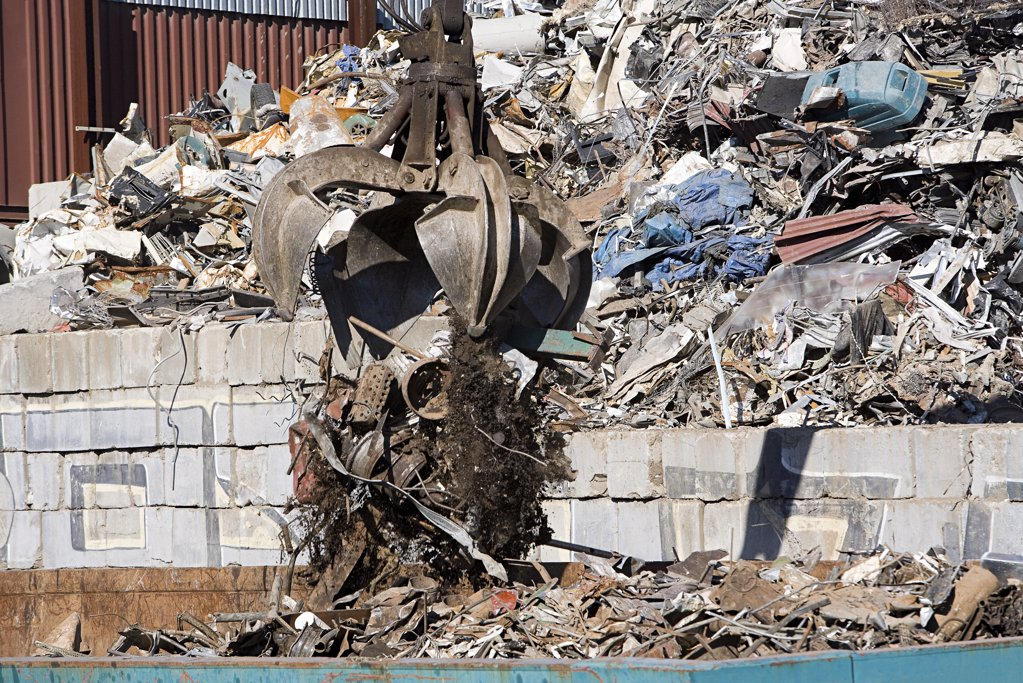 Stock Photo: 1439R-1104165 An excavator and rubble