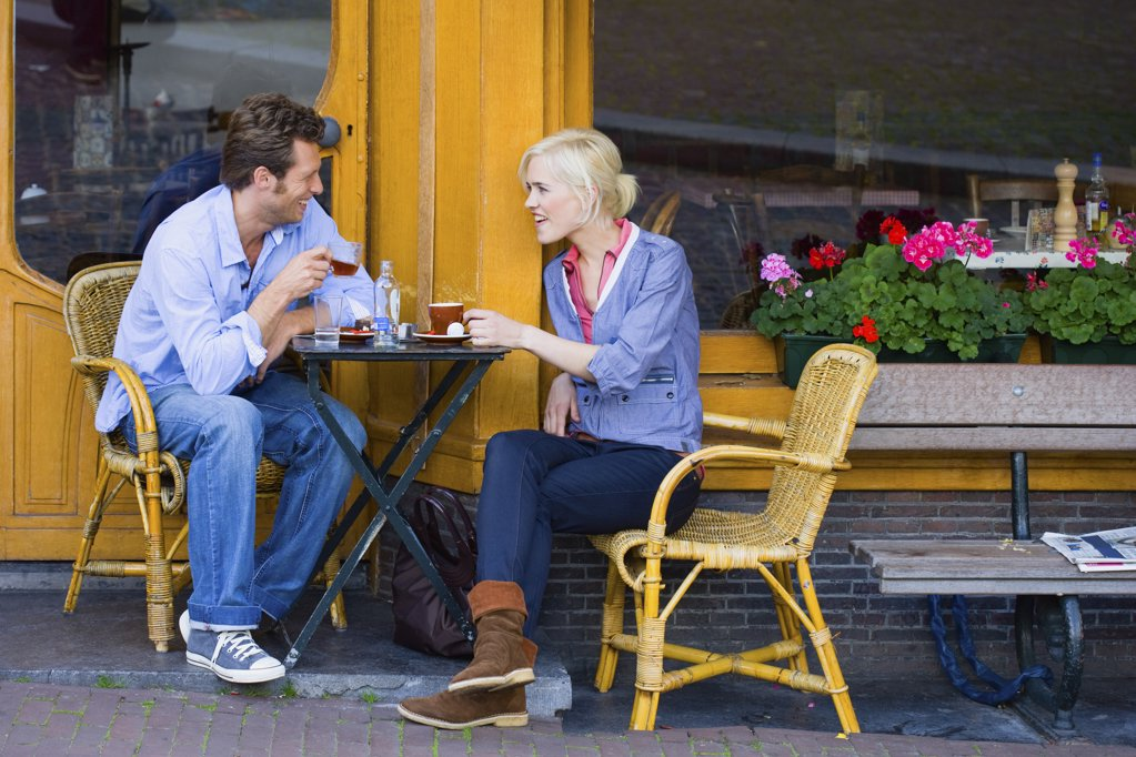 Couple at cafe : Stock Photo