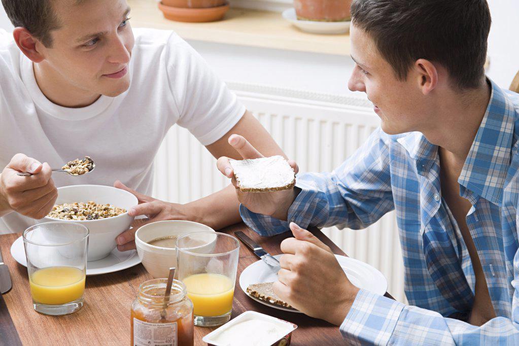 A gay couple having breakfast : Stock Photo
