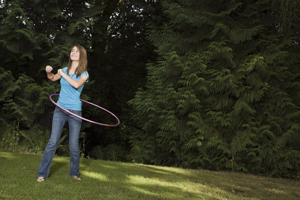 Stock Photo: 1439R-1107198 Teenage girl with plastic hoop