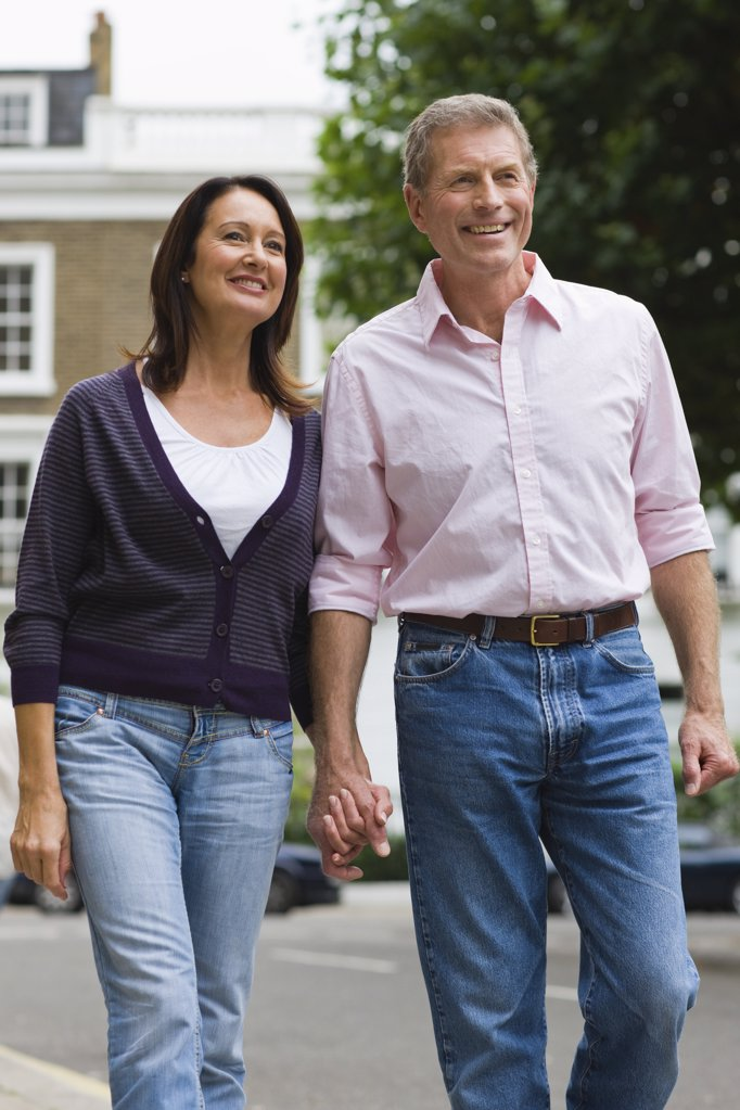 Stock Photo: 1439R-1107865 A couple walking down the street