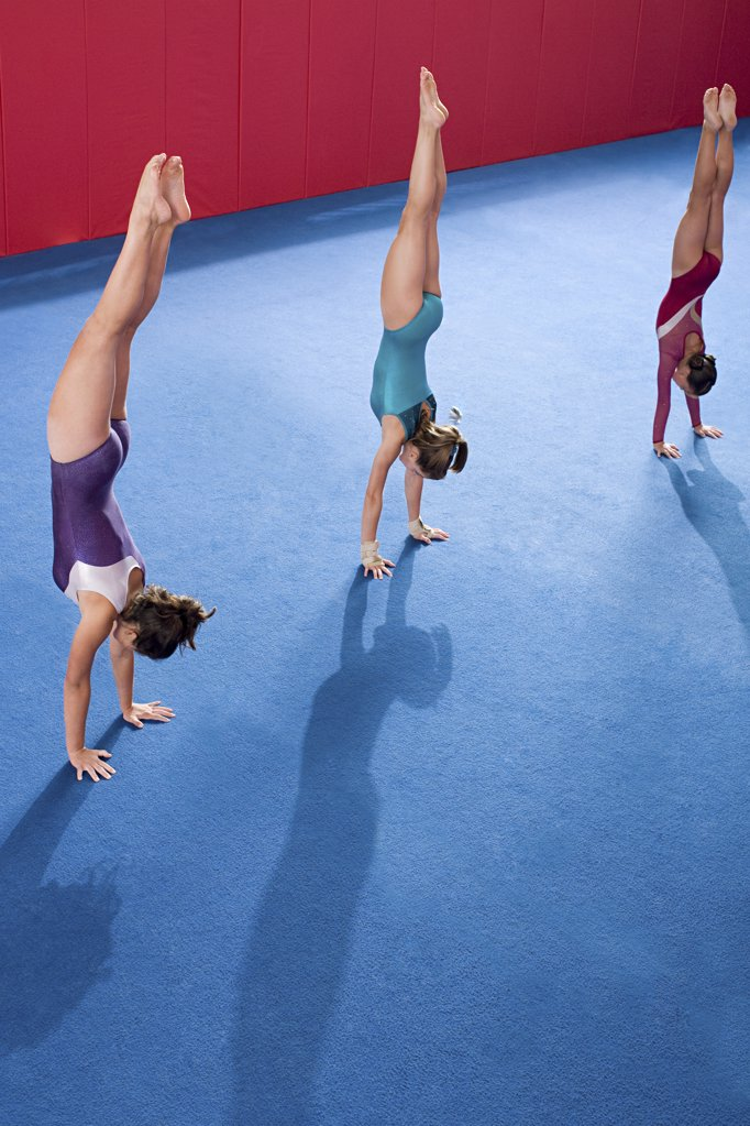 Gymnasts doing handstands : Stock Photo