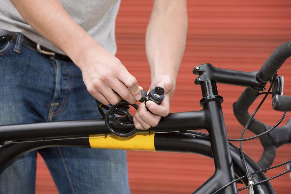 Man locking bicycle : Stock Photo