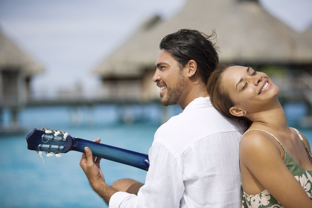 Stock Photo: 1439R-1109207 Romantic couple with guitar