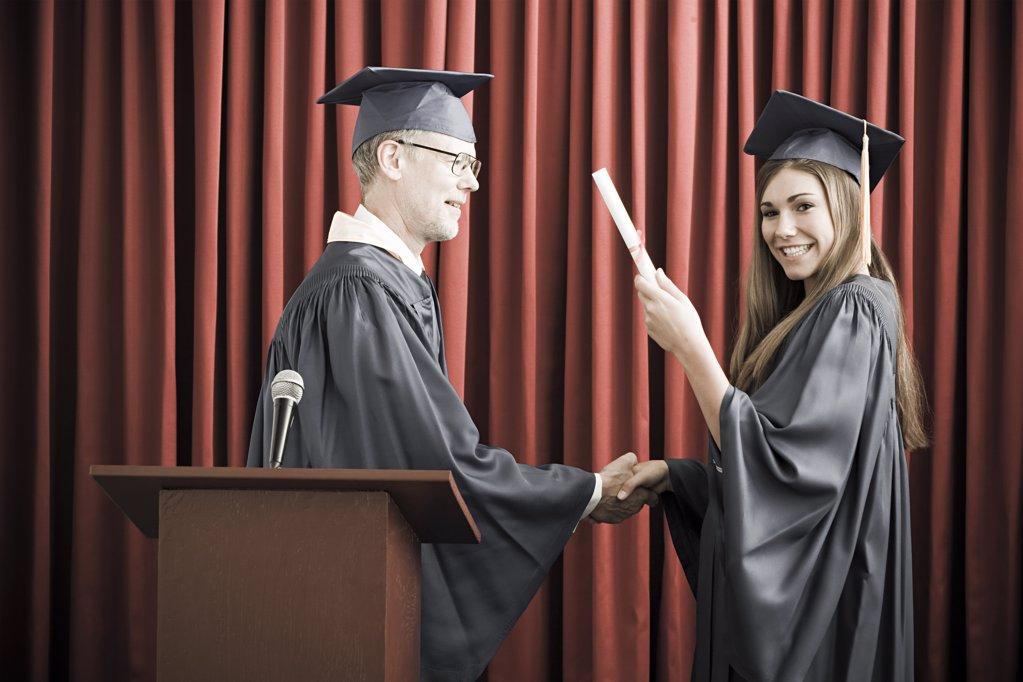 Stock Photo: 1439R-1110562 Girl graduating