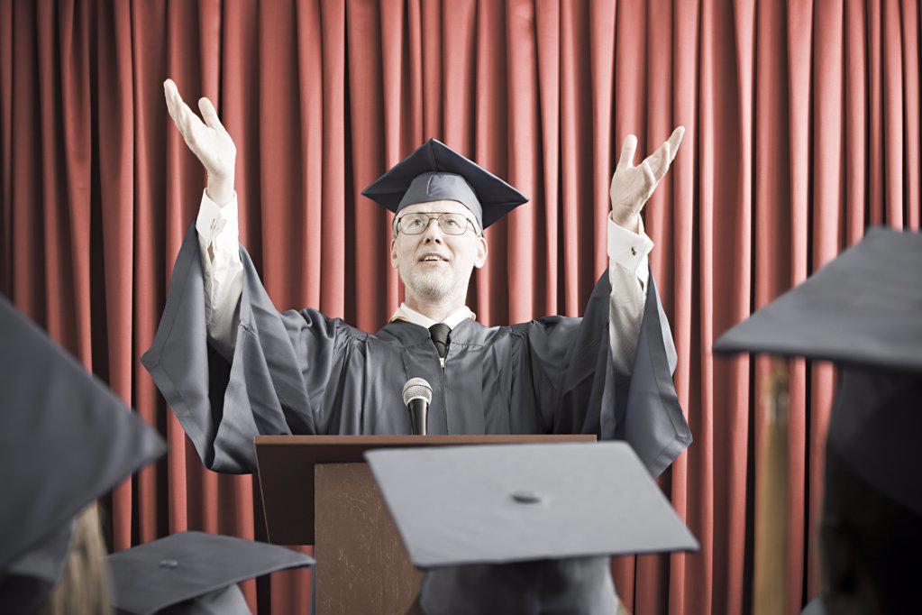 Dean giving graduation speech : Stock Photo