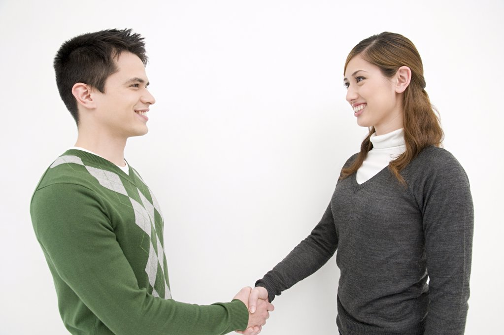 Office workers shaking hands : Stock Photo