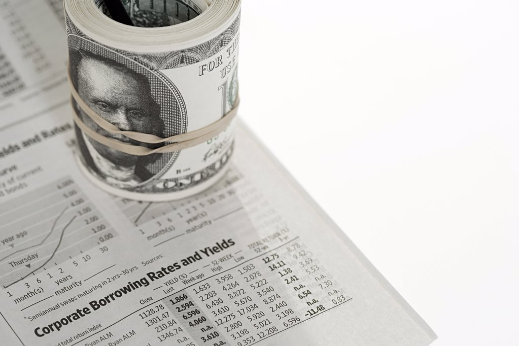 Banknotes on newspaper : Stock Photo