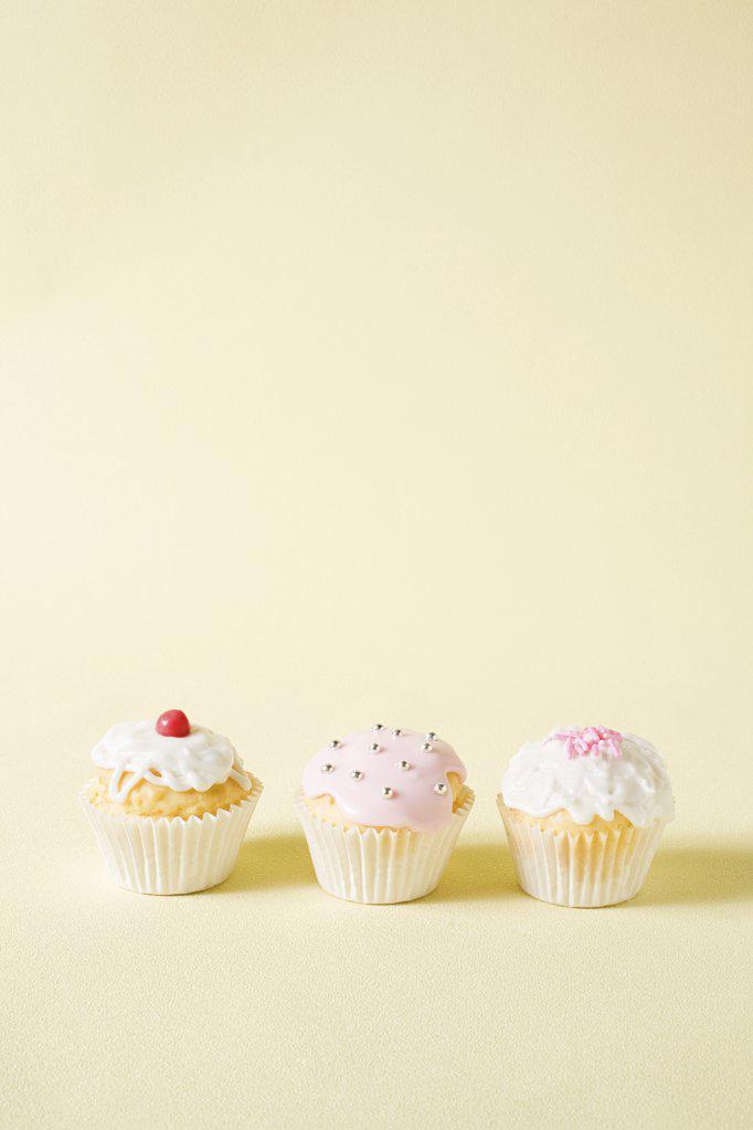 Stock Photo: 1439R-1111497 Three cupcakes
