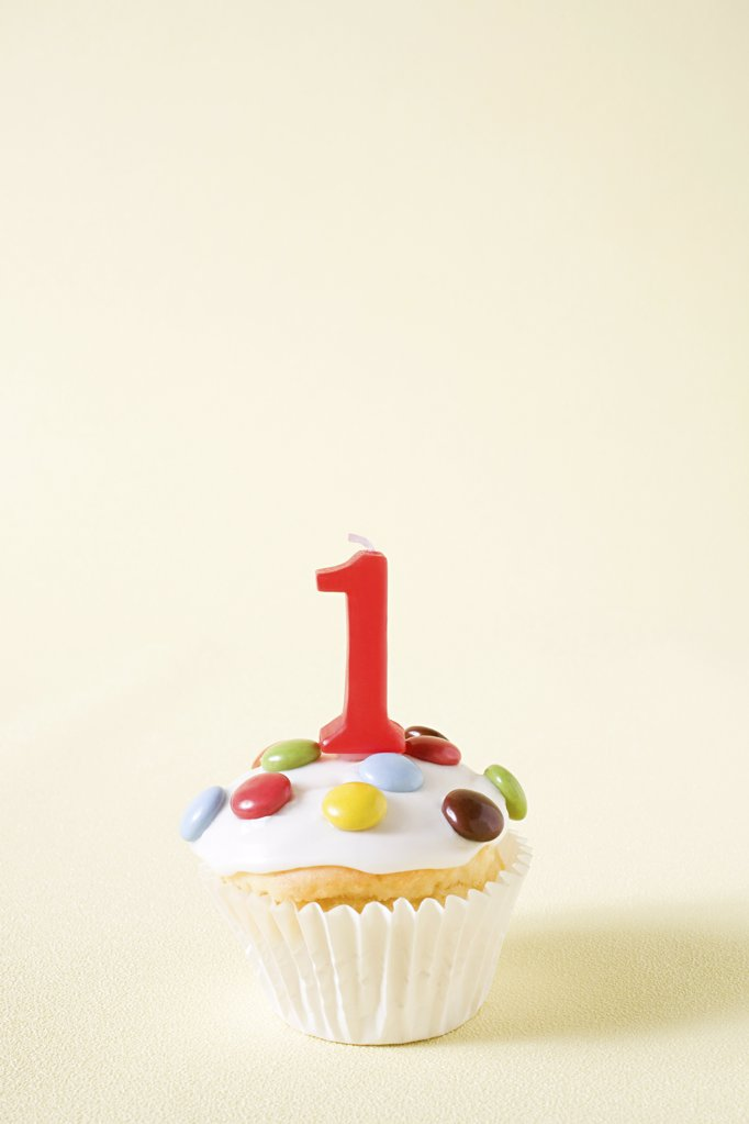 Cupcake with number one candle : Stock Photo