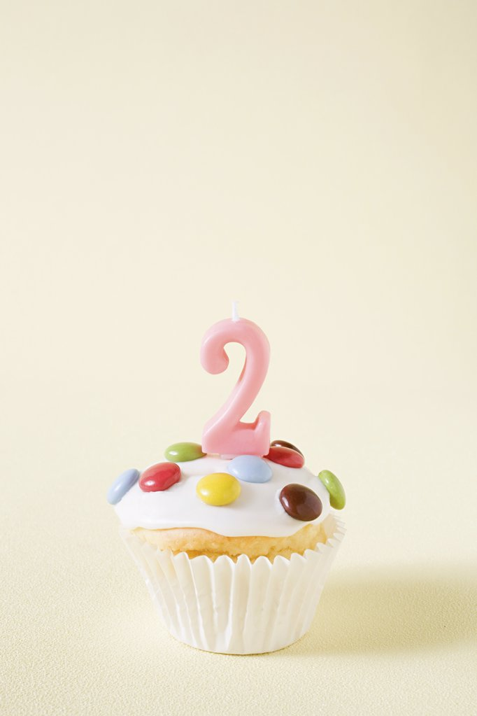 Stock Photo: 1439R-1111504 Cupcake with number two candle