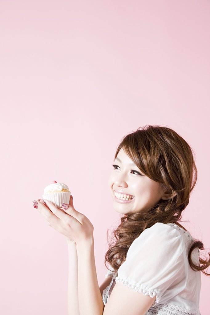 Woman holding cup cake : Stock Photo
