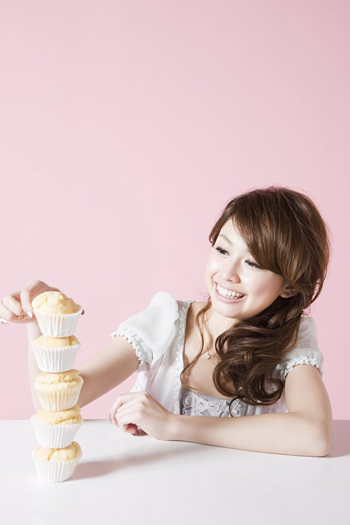Woman with stack of cakes : Stock Photo