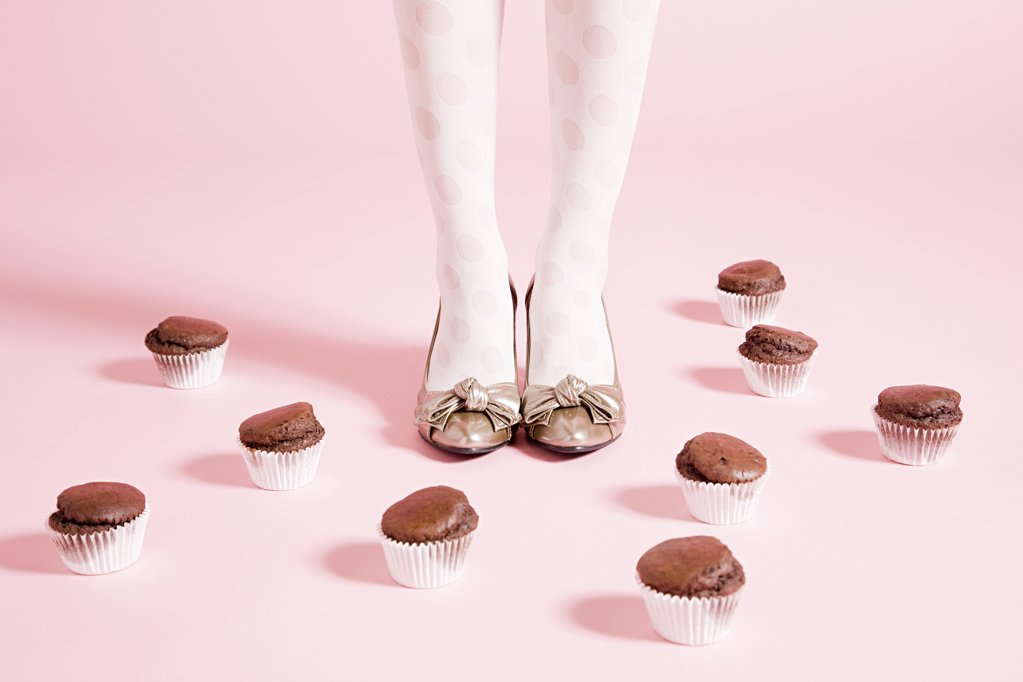 Legs of  woman and cakes : Stock Photo