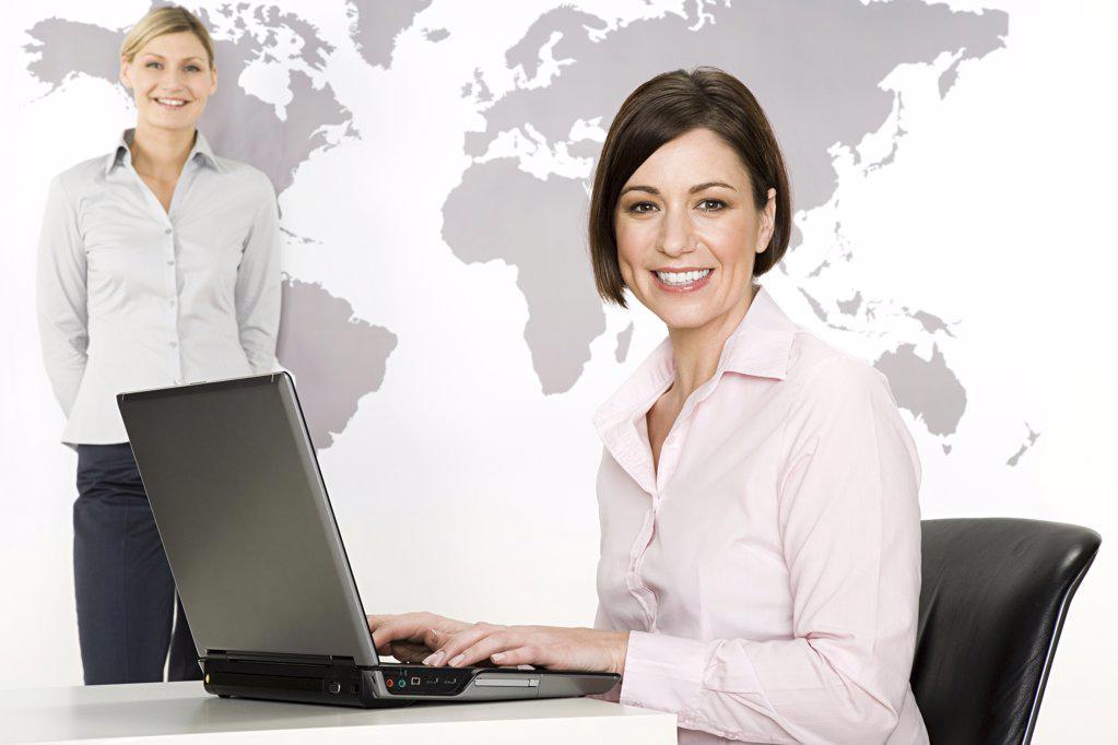 Businesswomen with laptop : Stock Photo