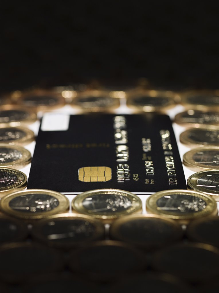 Credit card and euro coins : Stock Photo