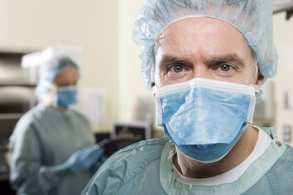 Stock Photo: 1439R-1113778 Surgeons in operating theatre