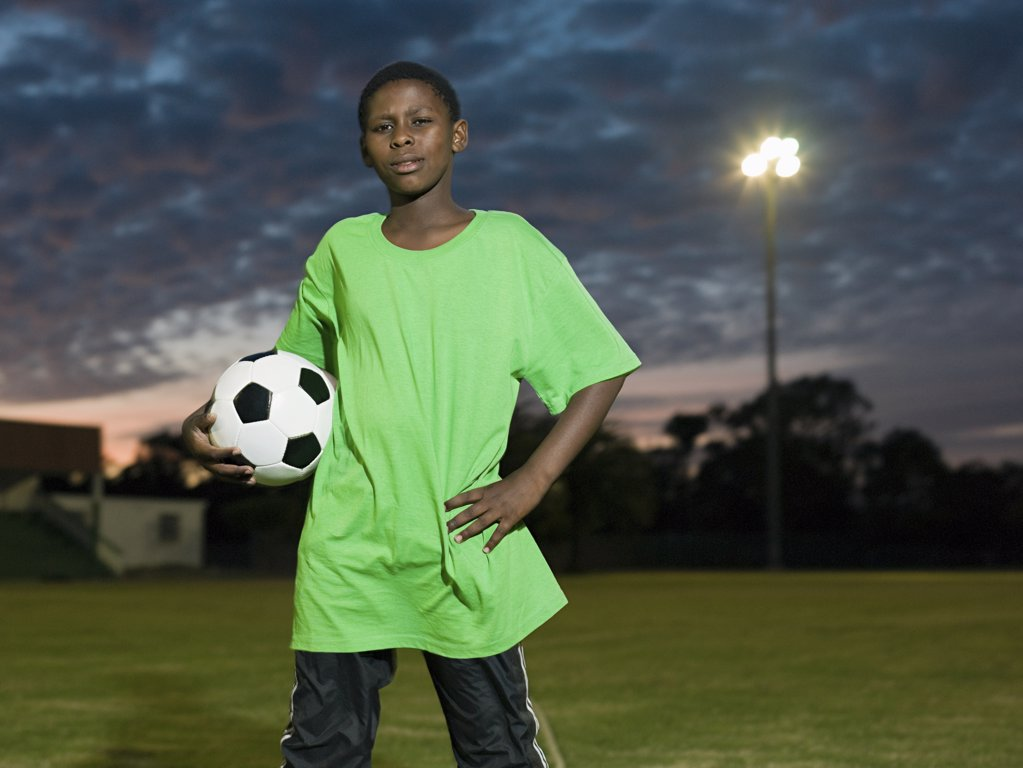 Teenage african boy with football : Stock Photo