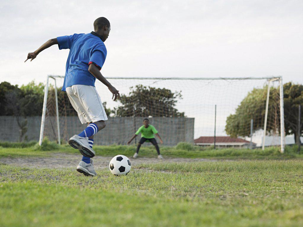 Teenage boys playing football : Stock Photo