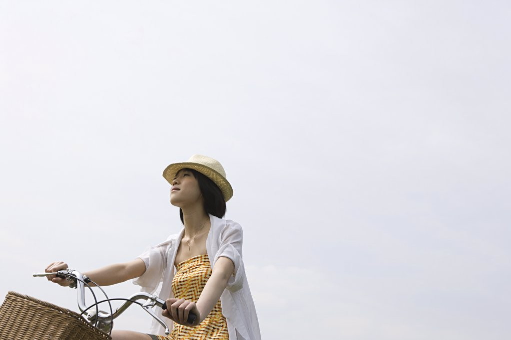 Young woman cycling : Stock Photo