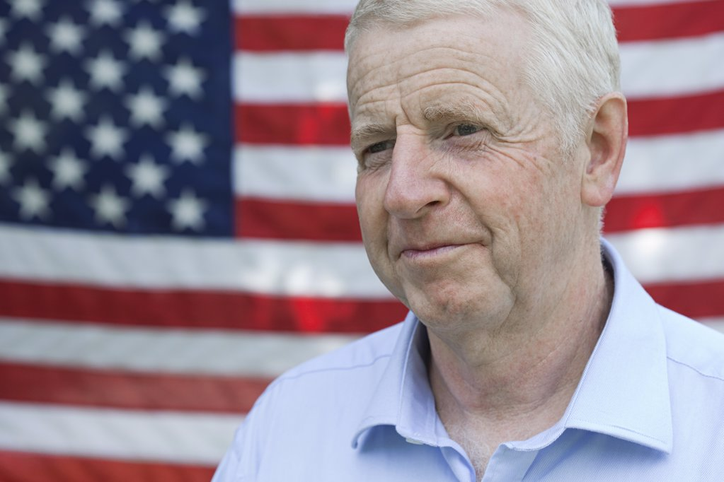 Stock Photo: 1439R-1115647 Senior man and and american flag