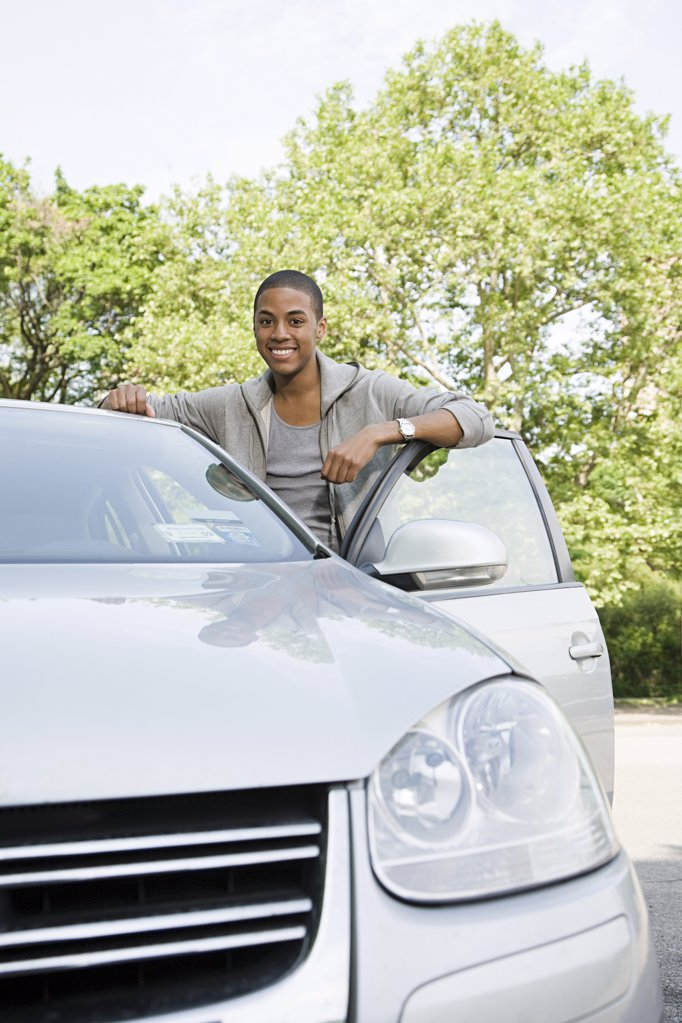 Smiling young man with his car : Stock Photo
