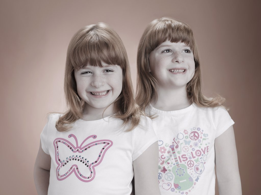 Identical twin girls : Stock Photo