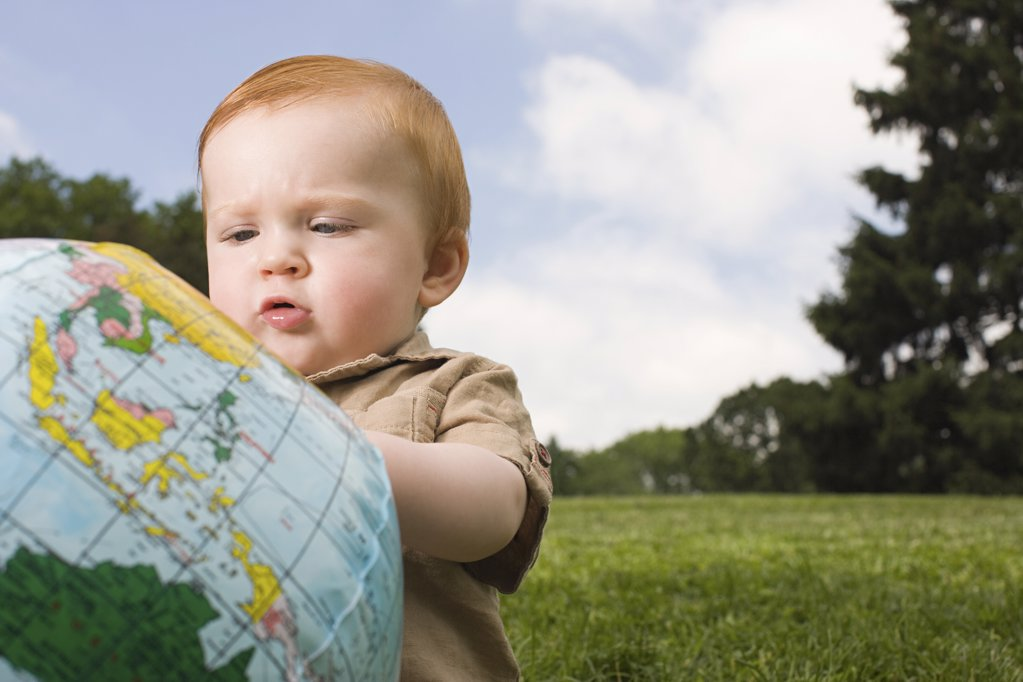 Stock Photo: 1439R-1116639 Baby with inflatable globe