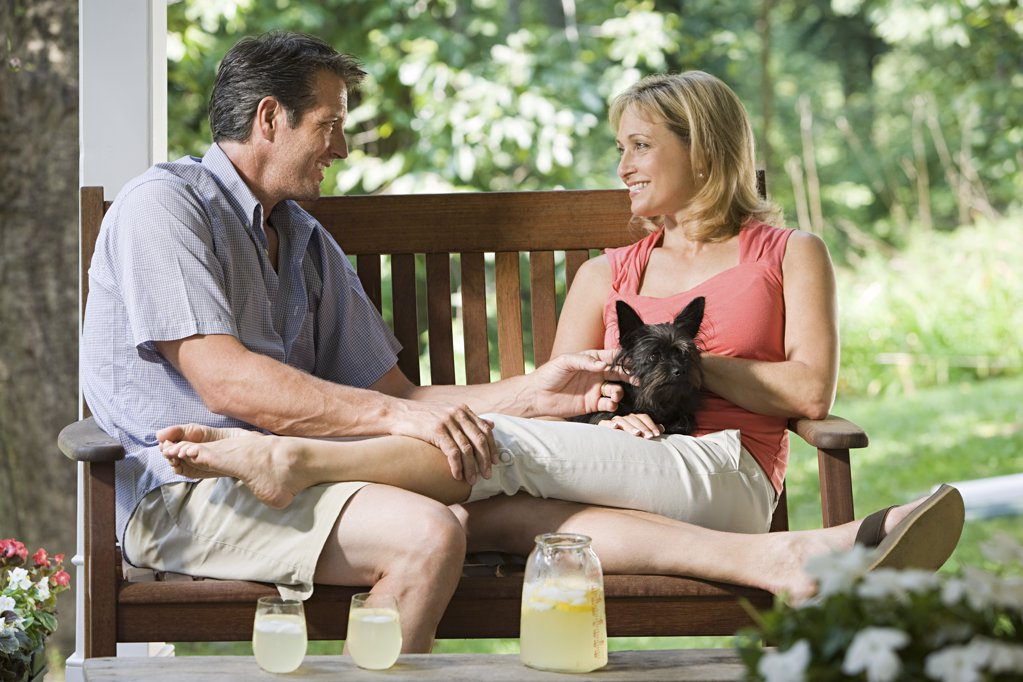 Stock Photo: 1439R-1117999 Couple on bench with dog