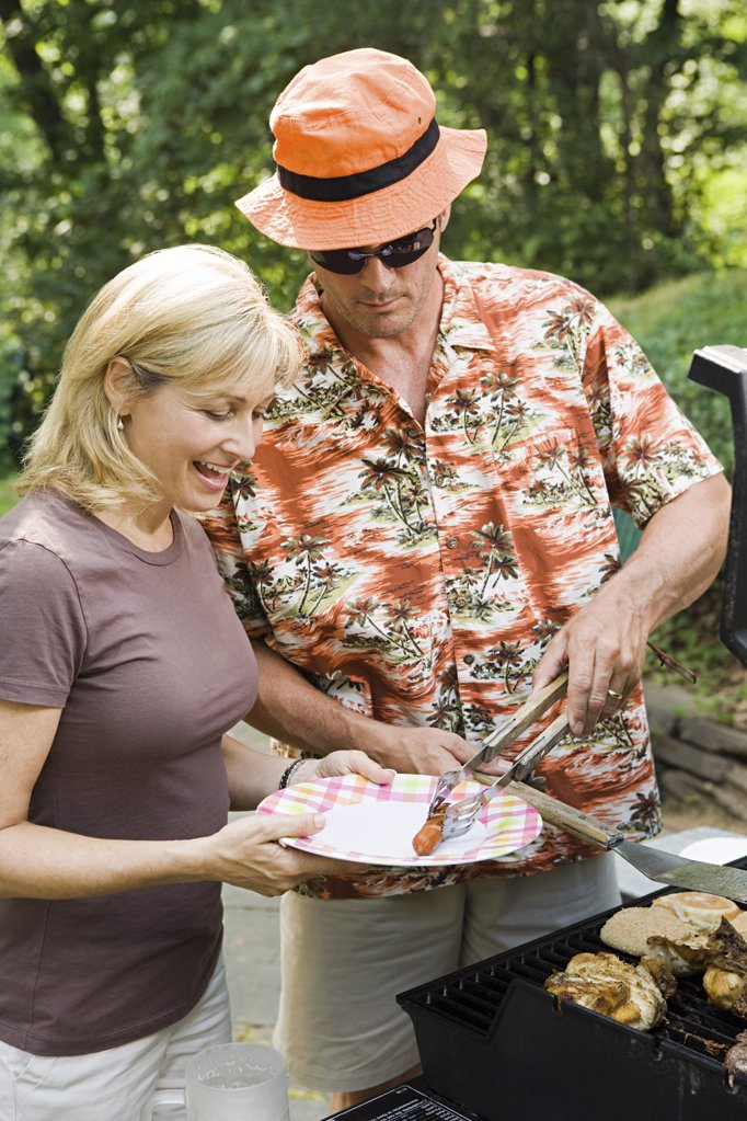 Stock Photo: 1439R-1118013 Couple having a barbecue