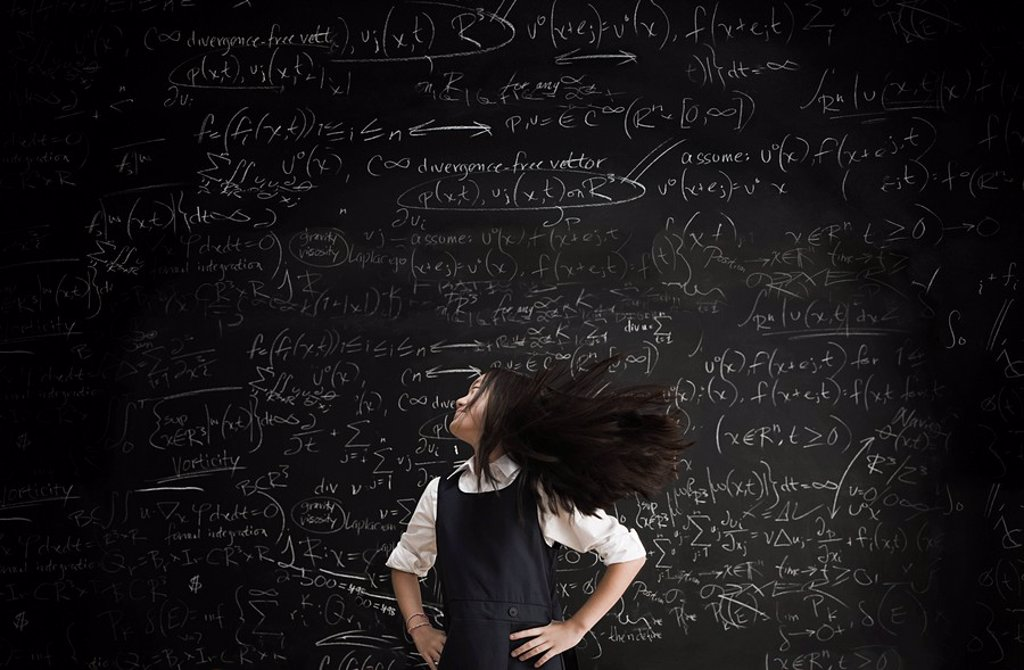 Stock Photo: 1439R-1118416 Girl moving in front of blackboard