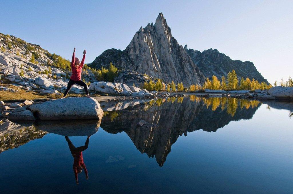 A woman practising yoga : Stock Photo
