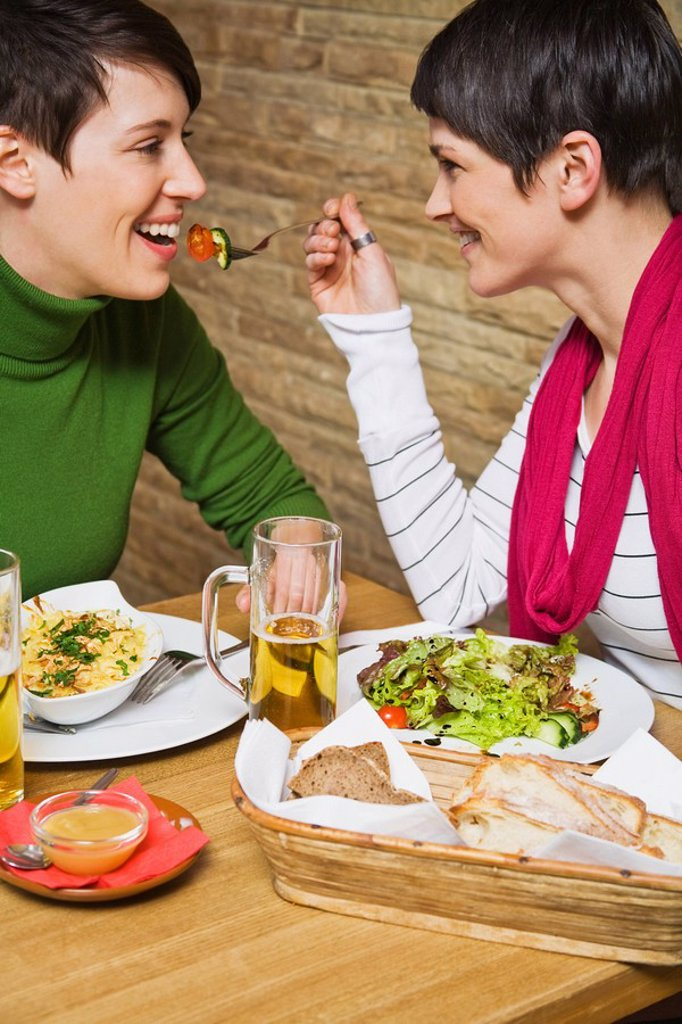 A lesbian couple having a meal : Stock Photo