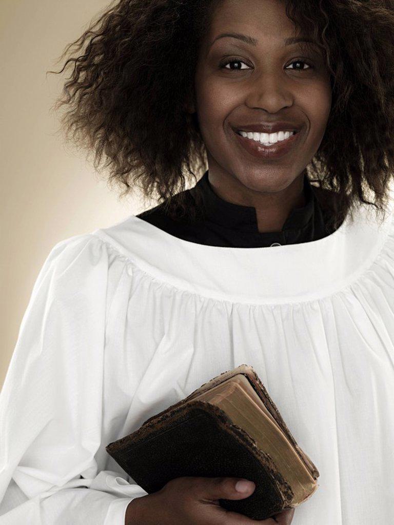 A gospel singer holding a bible : Stock Photo