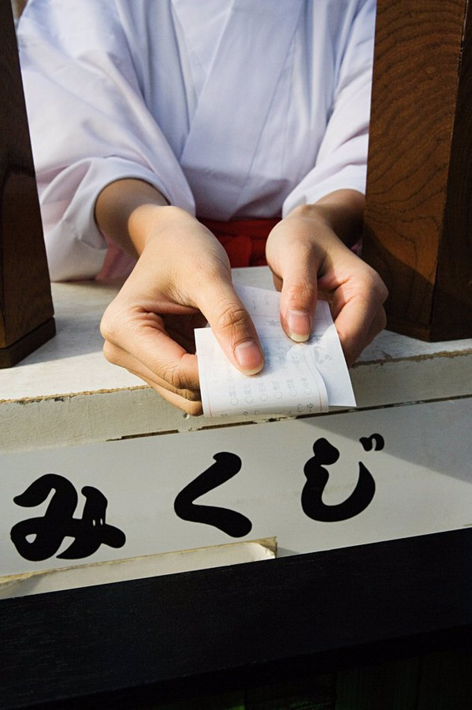 A woman holding a omikuji : Stock Photo